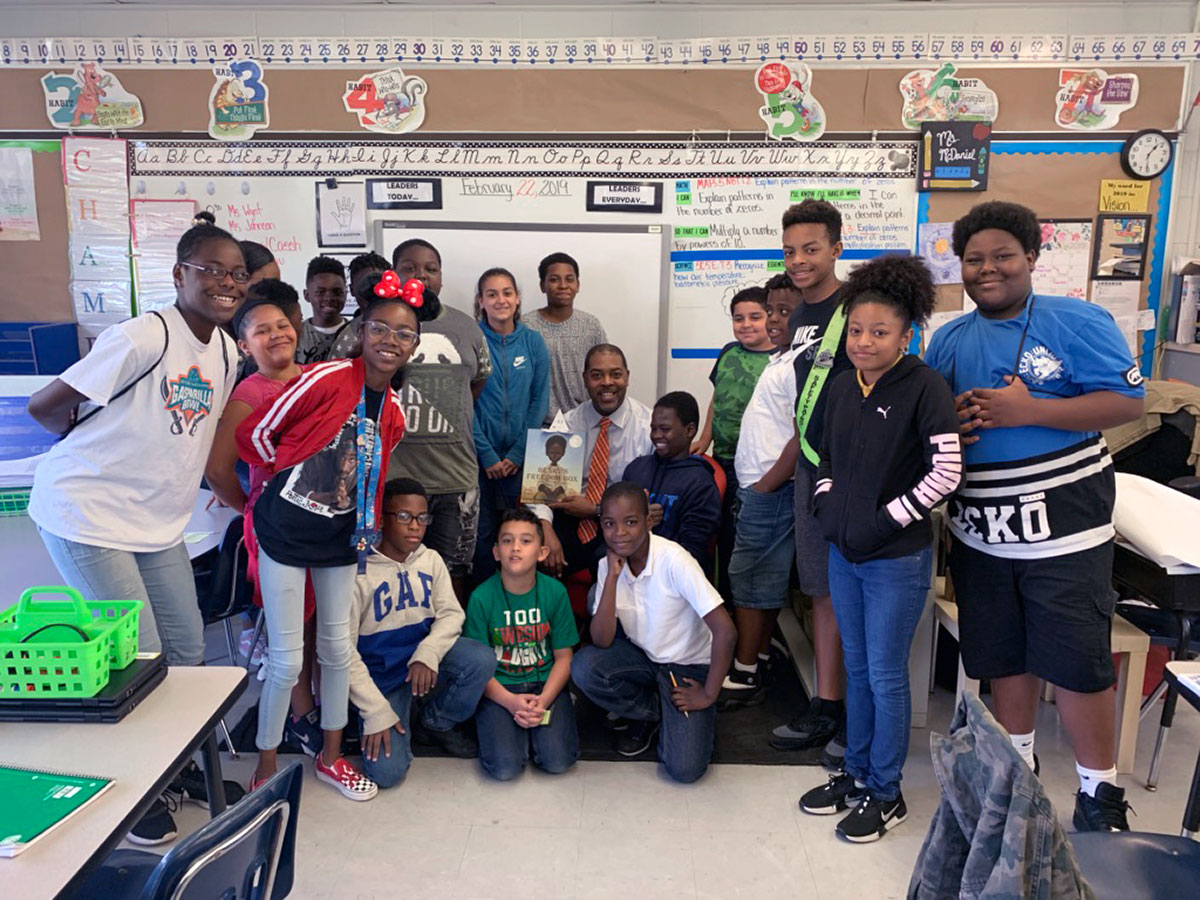 University of West Florida Graduate Harrison Peters in classroom with students