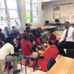 University of West Florida graduate Harrison Peters reading to students
