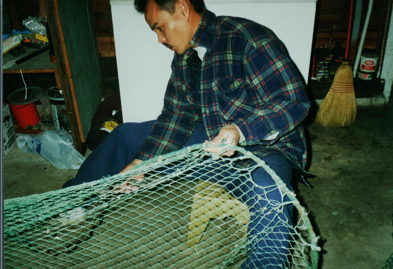 University of West Florida Graduate Hong Potomski, dad working on a shrimp net