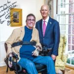 Senator Rick Scott and JR Harding, state disabilities advocate. Signed photo