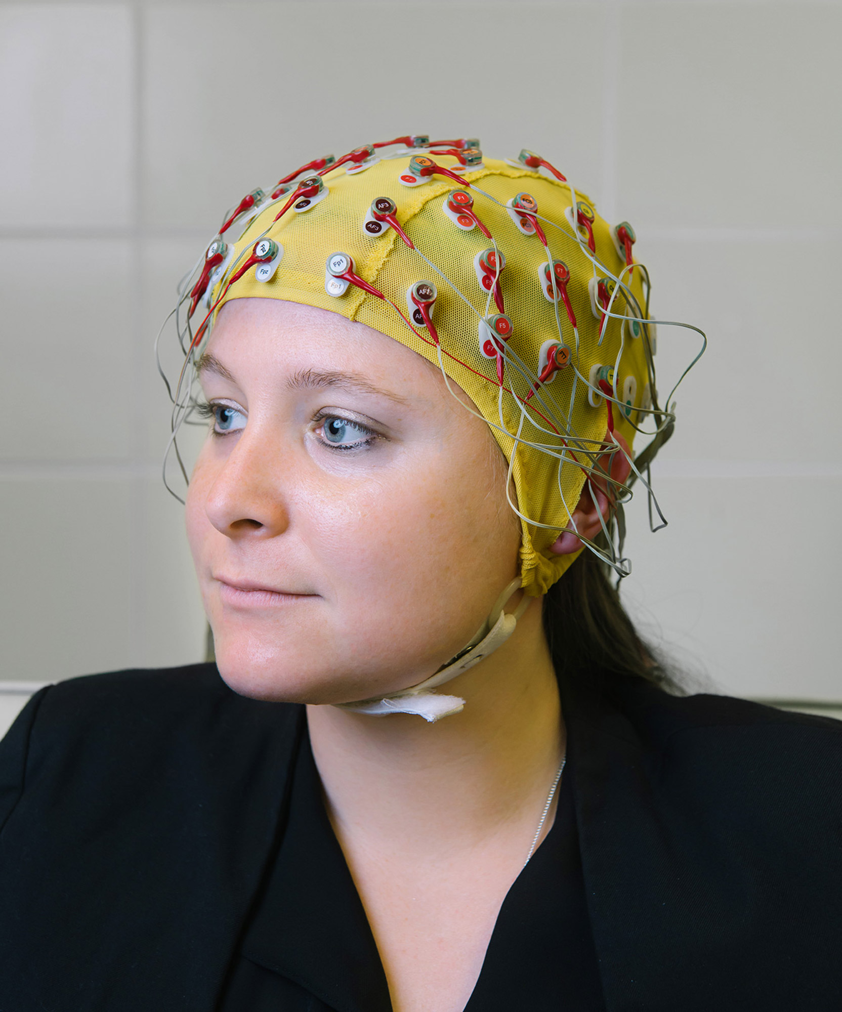 A good sport, Patricia is shown here modeling the EEG headset. Her research uses electroencephalography to determine the neural mechanisms, clinical implications, and educational benefits of music and music training on the brain and nervous system.