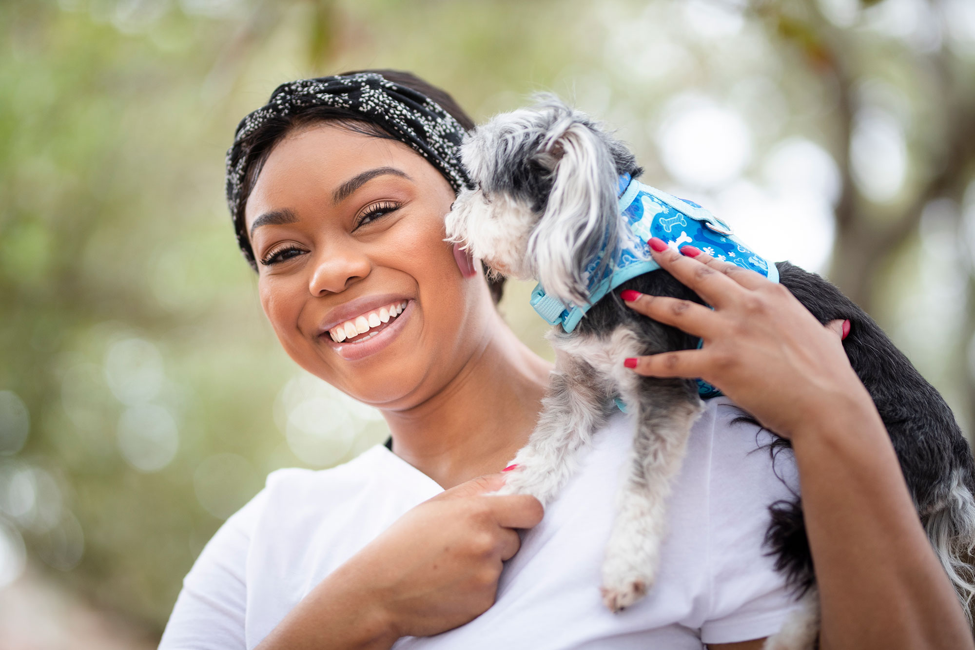 Close-up photo of Praise holding her Yorkie.