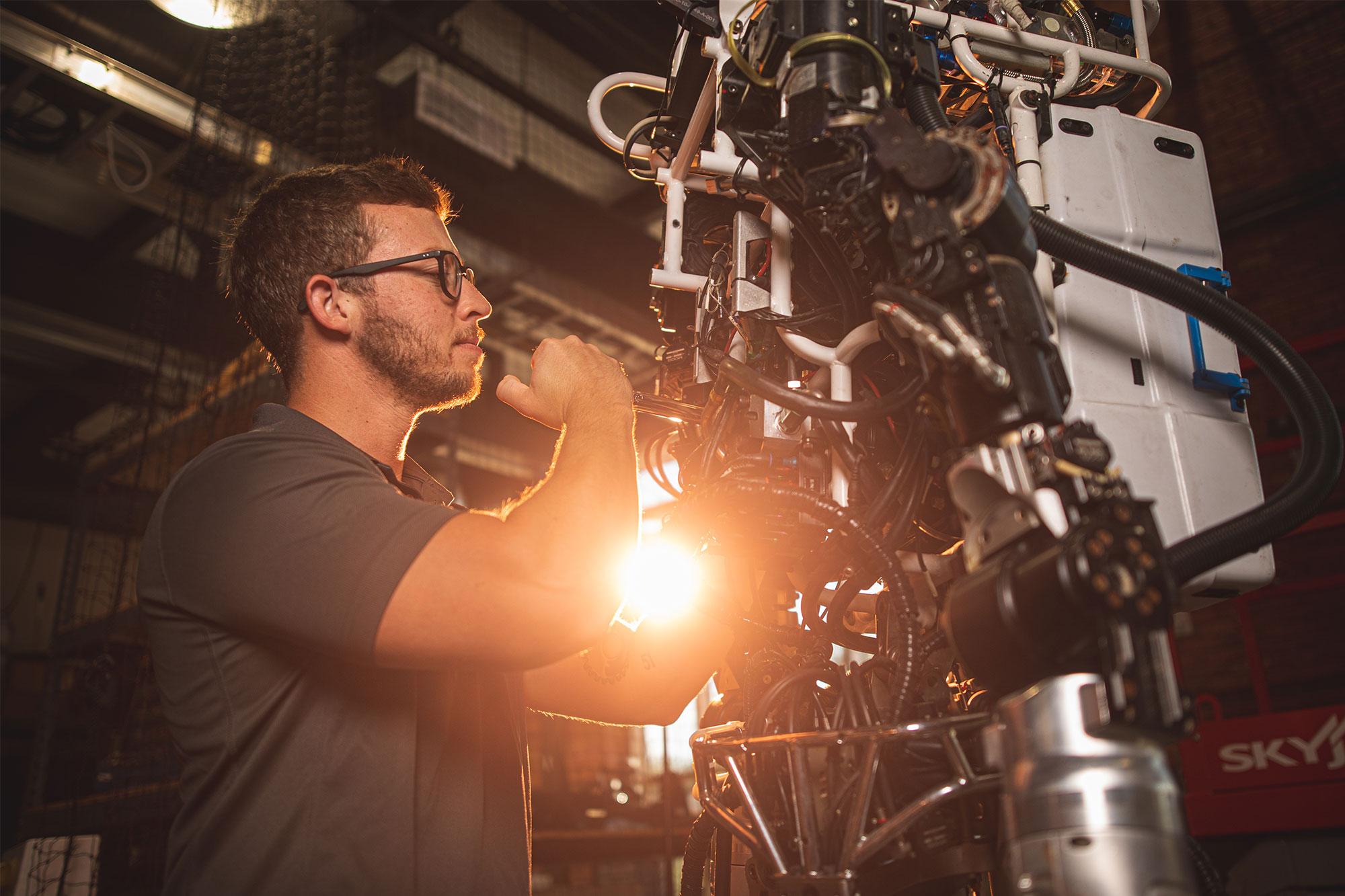 uwf steven thornton working in the robotics lab at IHMC