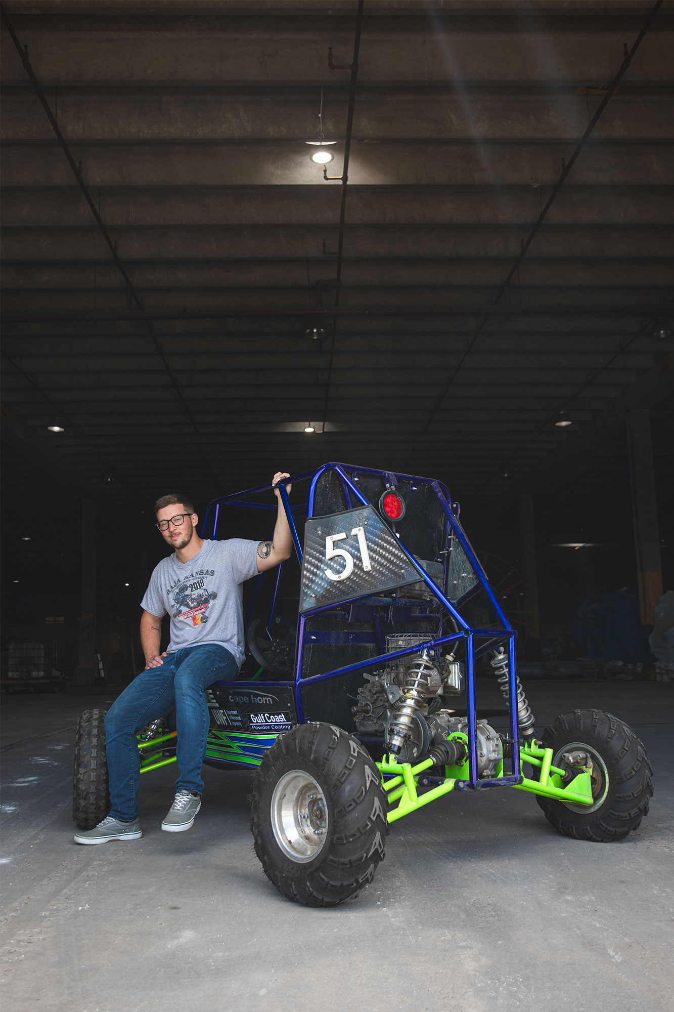 steven thornton with the off-road vehicle that was fabricated by UWF SAE Baja team that he led